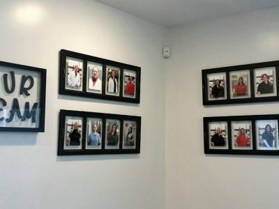 A photo wall displaying the team members in frames